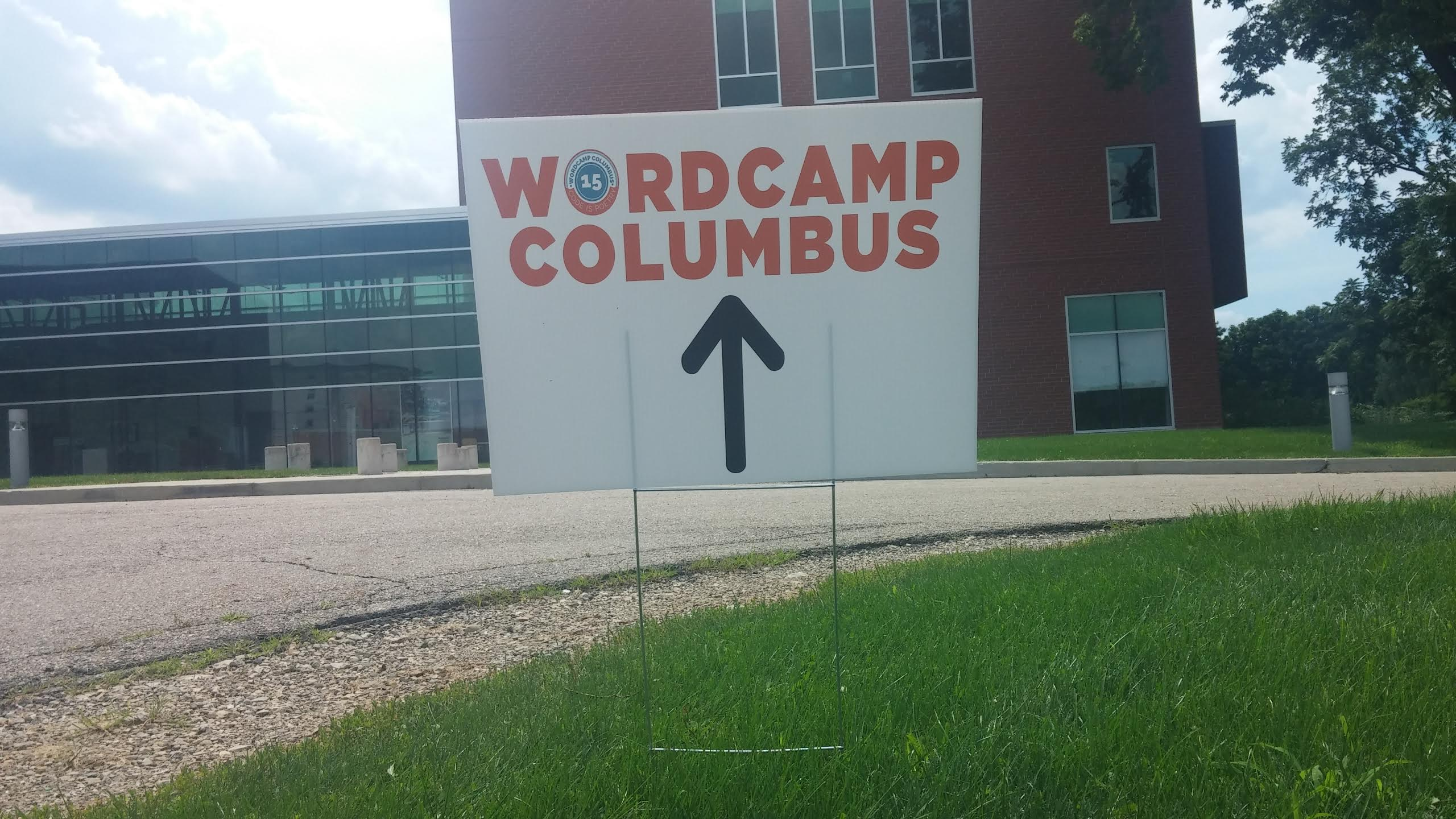 A directional sign pointing to the building where WordCamp Columbus 2015 takes place